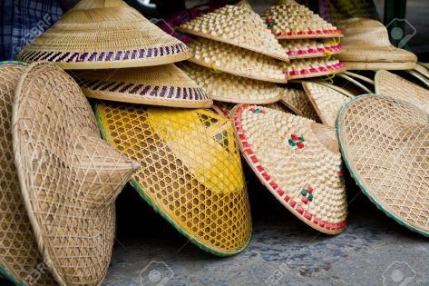 9925293-Row-of-Conical-Shaped-Rice-Farmers-Hats-in-Market-Stock-Photo-vietnam-hat-vietnamese